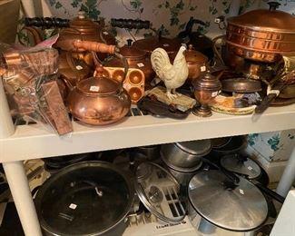 Copper tea pots, chafing dish server, miscellaneous pots and pans.