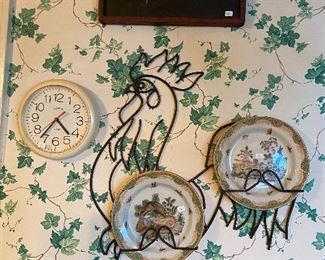 Rooster plate holder with decorator plates.