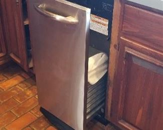 Great GE Profile trash compactor and yes, the kitchen floor is real brick!