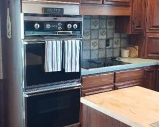 Solid wood kitchen cabinets by QuakerMaid; Roper double oven