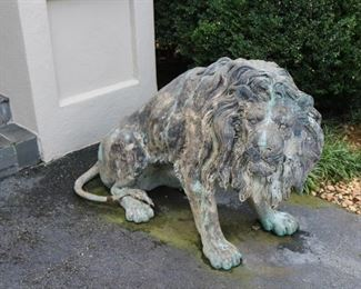 One of two large cast metal entryway  lions