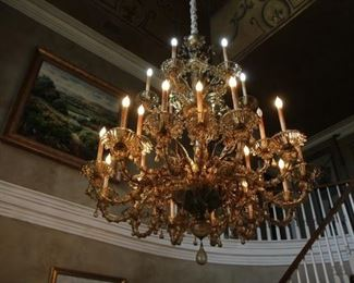 Massive Venetian style handmade Murano Glass two-tier Chandelier. Has 24 candlestick lights and dozens of adjustable arms. Glass is a gorgeous golden color with hints of brown. Incredible hand-blown drops, leaves and flowers throughout. There isn't a single inch of this piece that doesn't catch the eye.