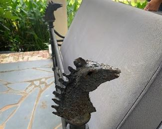 Wrought iron settee with dragon accents