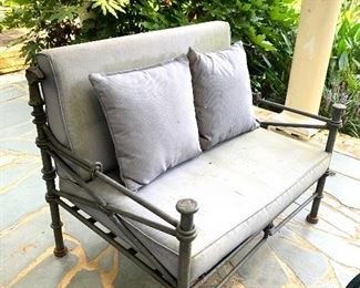 Wrought iron settee with dragon head accents (see next photo)
