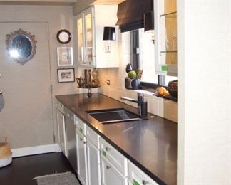 Cabinets with counters, sink and faucet @ $2,640