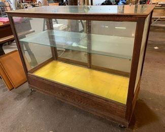 Wood and glass display shelf on wheels