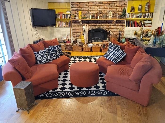 Four piece round burnt orange sectional with ottoman. Black and white checkered floor rug