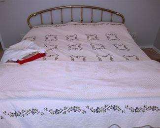 King bed, brass headboard