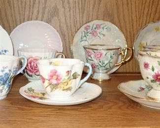 ASSORTED TEA CUPS AND SAUCERS