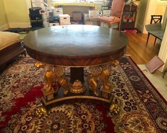Maitland Smith Parlor table. Known for their Hand Carved details and quality Furniture. Those are mythical GRIFFINS under there