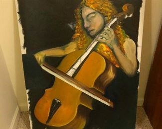 girl playing very small cello