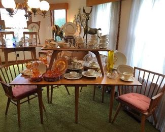 Conant Ball dining table and chairs, by Leslie Diamond.  Heywood Wakefield coffee table.  Lenox china.