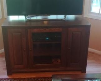 Smart Flat screen and stand, area rug, tables