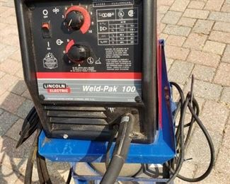 LINCOLN ELECTRIC WELD-PAK 100 WELDER, PLUS BLUE STEEL CART ON ROLLERS.  $250.00