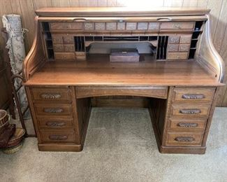 sixty four inch antique roll top desk