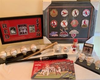 Interesting Collection of Cardinals World Series Patches. Baseball mini bats. Framed collection of signatures  including Musial and Schoendesinst along with a photograph of them together. 8 signed Baseballs In framed display sets. One Orioles baseball. Cardinals Calendars  .