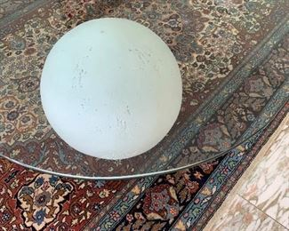 Glass table with ceramic ball.   $395.00