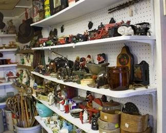 Variety of cast iron toys and figurines