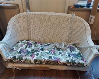 New porch swing White wicker with floral cushion  $400