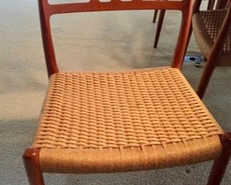 This GORGEOUS FalsterTeak Table comes with 10 chairs with woven cord seats