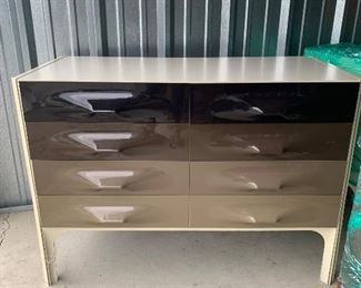 1 of 2!   Raymond Loewy Dressers and 1 nightstand that attach to a wall king headboard 1 nightstand missing) These pieces are designed with Loewys signature molded plastic drawer fronts and graduated bands of color, this one being in browns and tans.