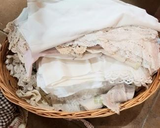 Several baskets of vintage and antique linen and lace