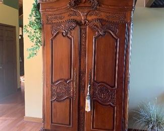 Heavily carved ornate antique armoire,  very stately! Quality at its finest!