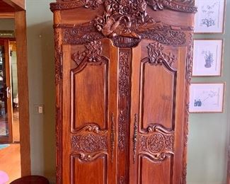 Heavily carved ornate antique armoire. Carved birds & flowers. What a gorgeous quality piece! Has two dovetail drawers inside and area to hang clothing. (or tv)
