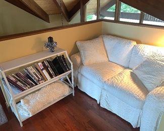 Cream love seat, bookcase