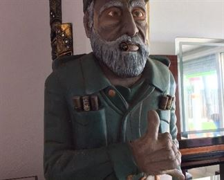 "Carved Wood Fidel Castro from Hawaii Cigar Store. Flashing the Hawaiian Shaka hand sign. 69 1/2"" H x 18 1/2"" W x 16"" D."