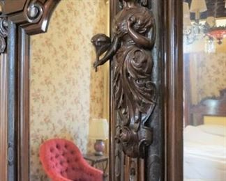 "Monumental Heavily Carved Italian Baroque Mahogany Two Door Armoire with lower single drawer.  Solid Carved full body Italian Maiden, Open Pierced Carved Crown and Original Urn Finials. on Carved Feathered Feet  Measures 110"" tall, 80"" wide & 25"" deep."