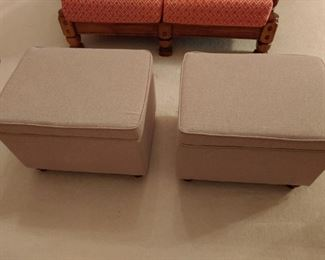 Set of upholstered ottomans with storage bins