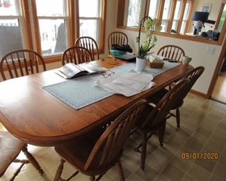 Dining table includes 4 extra leaves and ten chairs