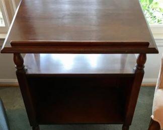 Tilt top display table