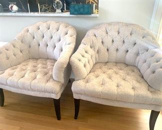 Pair of matching tufted chesterfield style chairs