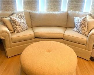 Curved off-white sofa from Havertys....ottoman has been SOLD