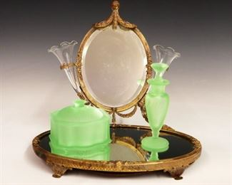 Early 20th century brass dressing plateau and mirror, with green satin glass powder and perfume bottle.