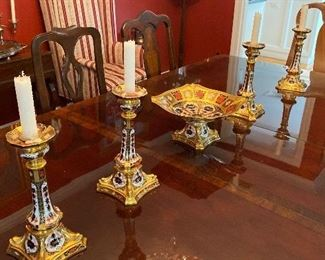 Royal Crown Derby Old Imari Pattern, two sets of candlesticks and compote, dolphin footed.  These are scarce early Imari pieces in mint condition.
