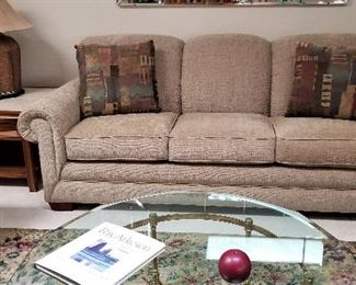 Neutral colored La-z-boy sleeper sofa and matching loveseat
