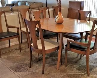 Mid-century modern kitchen/dining table with leaves and eight chairs. Rug also available.