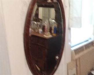 1 of two oval beveled glass oak framed mirrors