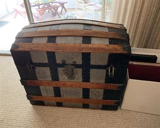 "#19	Metal and wood antique camel back trunk 29""x23""x18""	 $75.00"