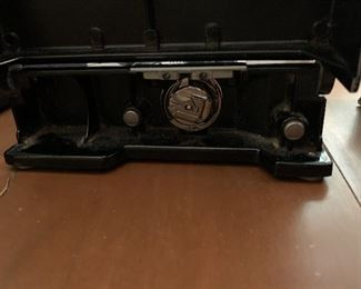 #64 Singer Featherweight Sewing machine serial #AK579219 it is clean, wheel turns smoothly, it has metal bobbin housing, attachments, foot pedal, booklet, and case, it is in beautiful condition! $375.00