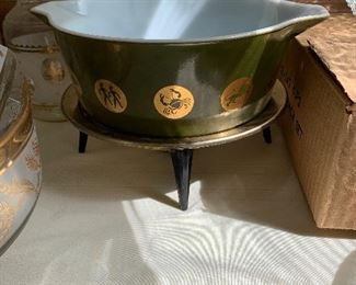 #99Vintage Pyrex with zodiac signs and stand $40.00
