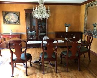 dining room table and 10 chairs with three leaves and table covers