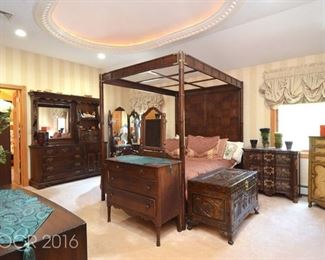 Beautiful canopy bed and end tables and carved trunk