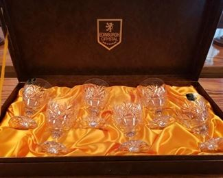 https://ctbids.com/#!/description/share/545051 Edinburgh Crystal Cameron Pattern (flower of Scotland). Set of 6 glasses. Made in Scotland. Brought home from Scotland as a gift from owner's husband over 40 years ago.