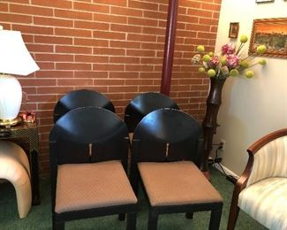 Set of four black, modern in styling dining chairs.