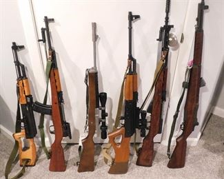 From Left: Romanian AK74, Chinese SKS Type 56, Sturm Ruger Ranch Rifle, Norinco AK47, Yugo Model 59/66, 1943 Springfield M1 Garand. More firearms and ammo available at the sale.