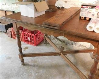 Antique table with 2 leaves. Antique tool chest with tools.